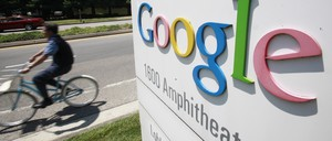 A man bikes past the Google campus in Mountain View