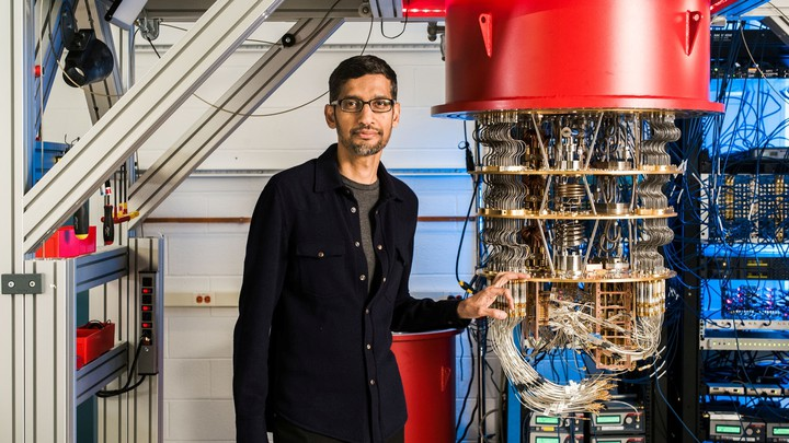 Google CEO Sundar Pichai stands beside a quantum computer.