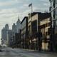 People walking along a deserted street in Detroit, Michigan