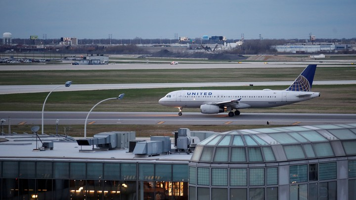 A United Airlines aircraft lands at O'Hare International Airport in Chicago, Illinois on April 11, 2017.