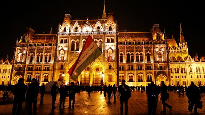 Opponents of Hungary's new labor law demonstrate in front of the Parliament building in Budapest in December.