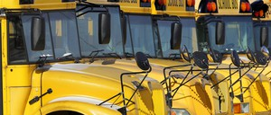 Public school buses are parked in Springfield, Ill.