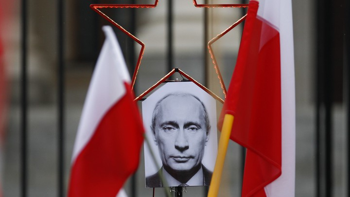 A photo of Russian President Vladimir Putin between two Polish flags