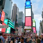 photo: a crowded scene of Times Square in NYC