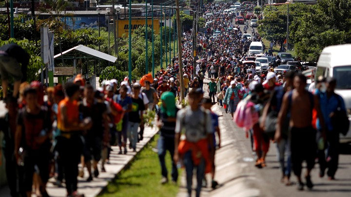 Central American migrants walk along the highway in Tapachula, near Mexico's border with Guatemala, on October 21 as they continue their journey toward the U.S. border.