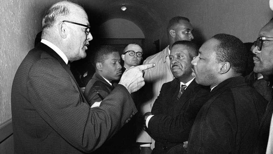"""During a meeting in Hayneyville, Alabama, on March 1, 1965 King inquired about voter registration procedures but Registrar Carl Golson told him """"It's none of your business."""""""