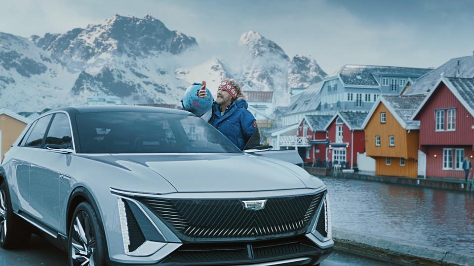 Will Ferrell holds his phone aloft standing in a Scandinavian scene.