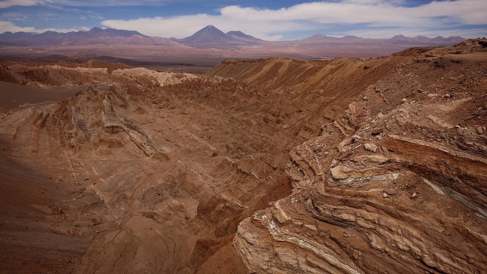 The dry, red, rocky landscape of the Atacama Desert.