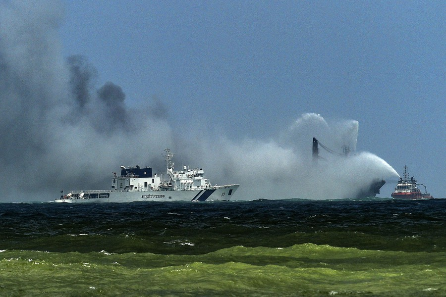 Firefighting boats attempt to put out a ship fire.