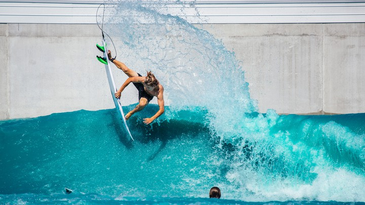 A surfer in a wave pool in Waco, Texas