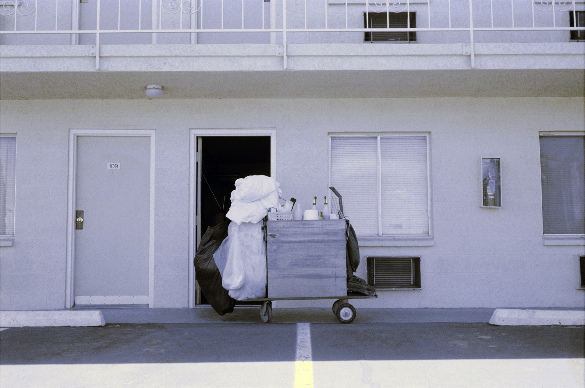 A motel cleaning cart in front of an open door