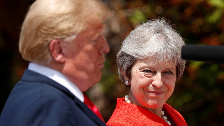 British Prime Minister Theresa May reacts as she and President Trump hold a press conference at her country home in Chequers on July 13, 2018.