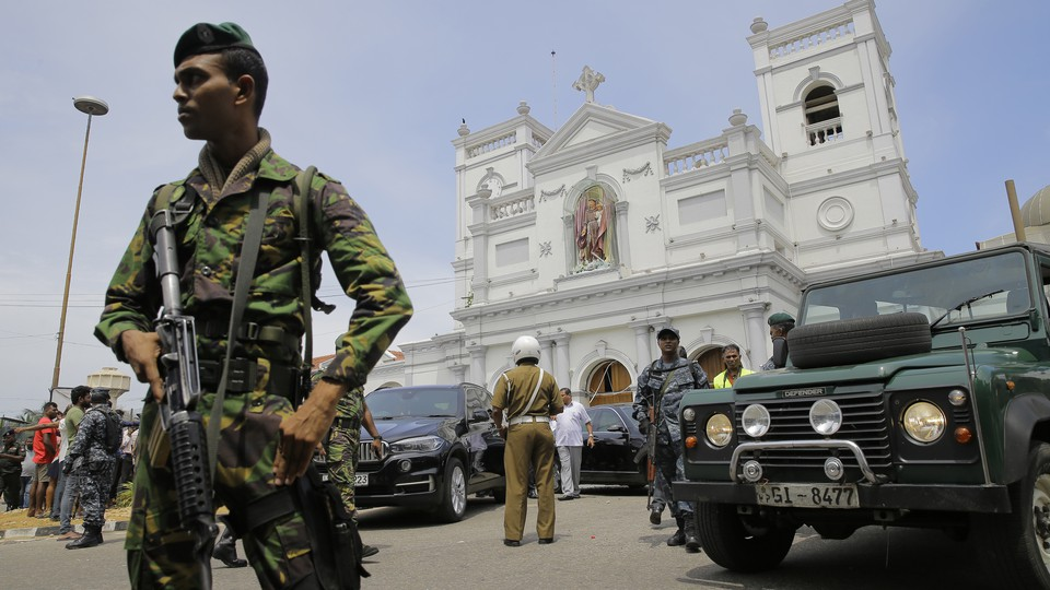 A Sri Lankan soldier secures the area outside an attack at St. Anthony's Shrine in Colombo on April 21.