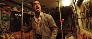 """A photo of an blood-covered actor in a subway car from """"Nightmare: New York,"""" a haunted house attraction from 2014."""