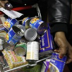 A shopper peruses the offerings at the Food Bank For New York City Community Kitchen & Food Pantry of West Harlem.