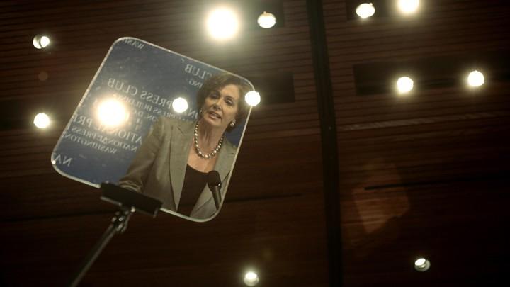 Nancy Pelosi reflected in a teleprompter in 2007