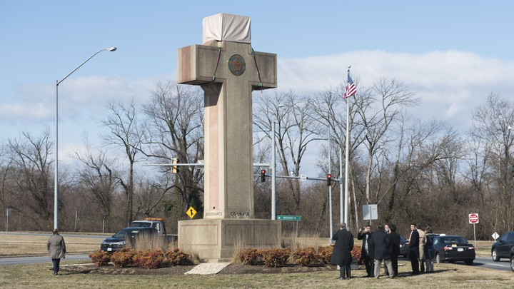 Visitors walk around the 40-foot Maryland Peace Cross in 2019