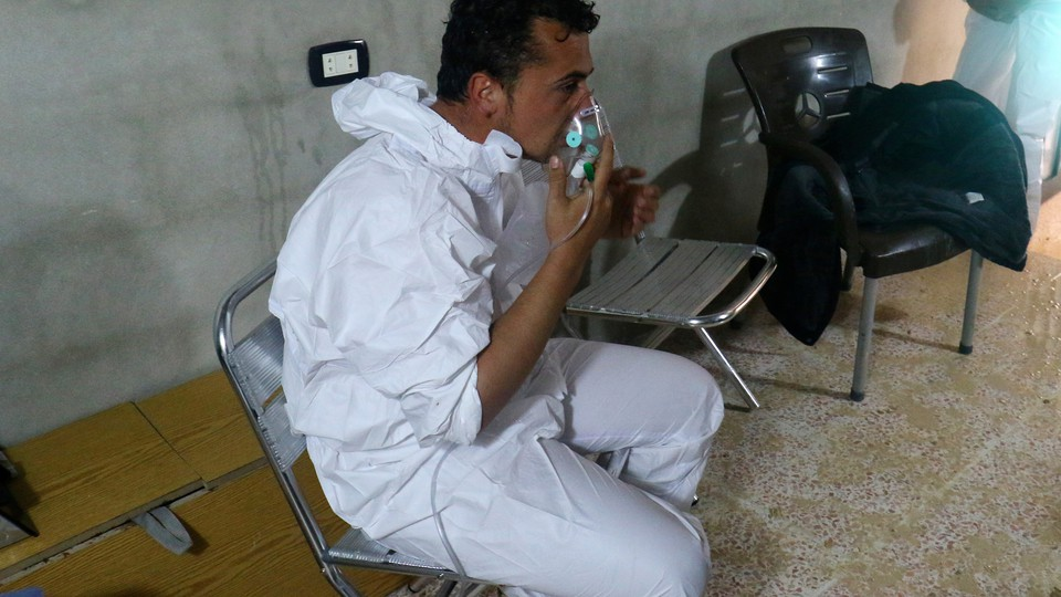 A man breathes through an oxygen mask, after what rescue workers described as a suspected gas attack in the town of Khan Sheikhoun in rebel-held Idlib, Syria, on April 4, 2017.