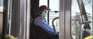 photo: A bus driver in New Rochelle, New York, wears a protective mask.