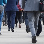 Workers in downtown London head to their jobs.
