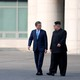 Kim Jong Un and Moon Jae In walking