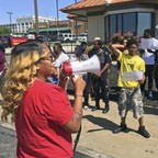 Activists hold a rally outside a McDonald's in Saint Louis, Missouri