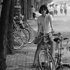 A 1980s photo of a girl riding her bike in Beijing.