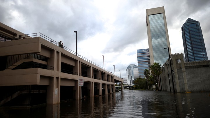 A couple looks at flood waters in Jacksonville, Florida on Monday, September 11, 2017.