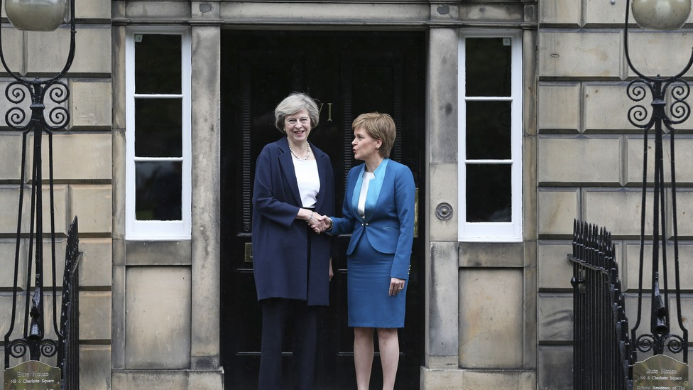 Scotland's First Minister, Nicola Sturgeon, greets Britain's new Prime Minister, Theresa May, as she arrives at Bute House in Edinburgh, Scotland, on July 15, 2016.