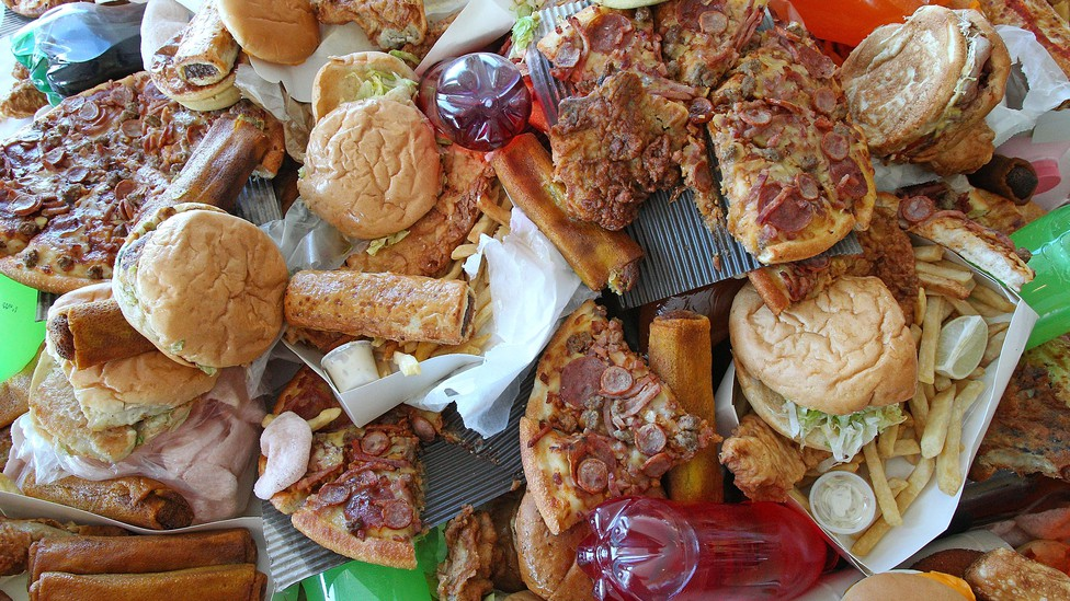 A large pile of unhealthy foods