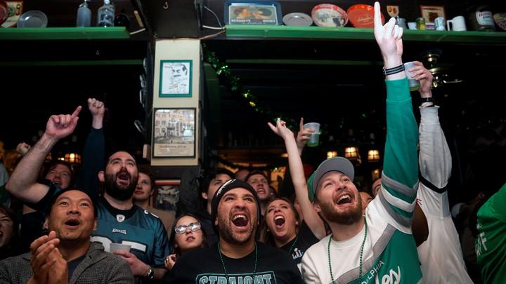 Football fans watch the Super Bowl.