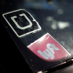 Uber and Lyft logos are pictured.