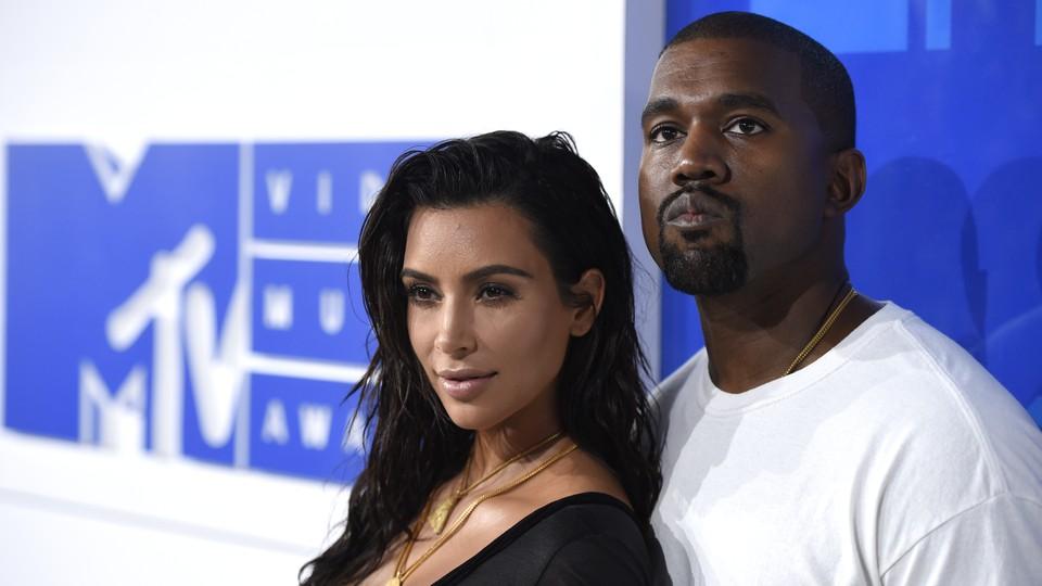 Kim Kardashian and Kanye West pose for a photo