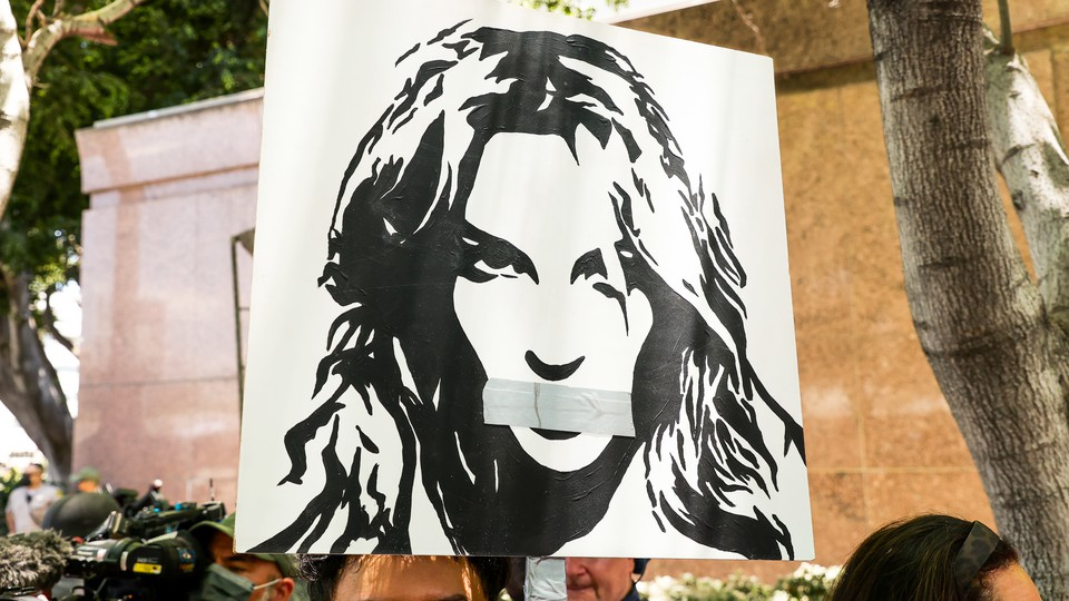 Activists protest during a conservatorship hearing for Britney Spears.