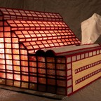 A photo of Kurt Treeby's tissue-box replica of a building designed by Cesar Pelli.