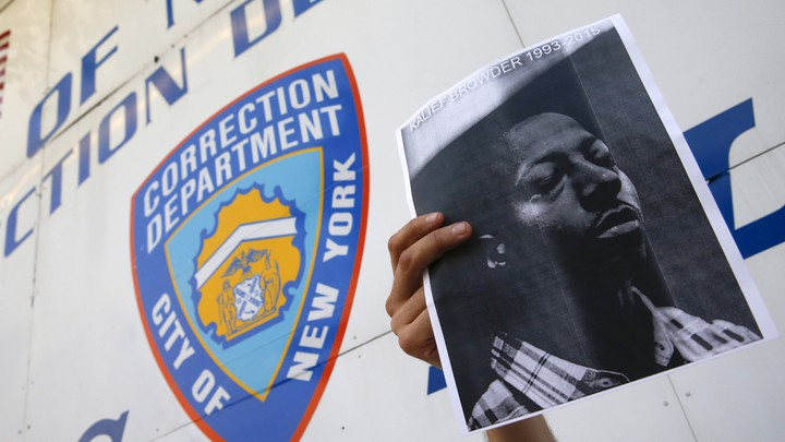 A picture of Kalief Browder in front of a building on Riker's Island