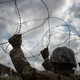U.S. Army soldiers install concertina wire along the U.S.-Mexico border in Hidalgo, Texas.