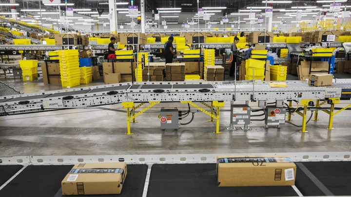 Workers at an Amazon f​ulfillment center in Staten Is​land