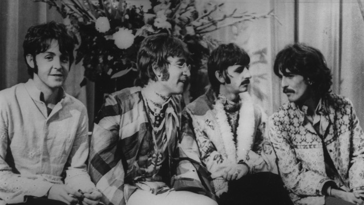 The Beatles attend a lecture given by Maharishi Mahesh Yogi