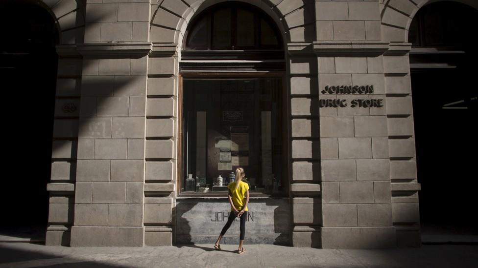 A girl looks into a shop window