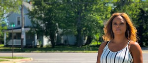 a photo of Tara Conley outside novelist Toni Morrison's birthplace in Lorain, Ohio, not far from Cleveland.