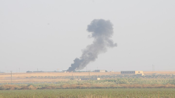 Smoke rises from the Syrian side of the border as it is pictured from the Turkish town of Akcakale in Sanliurfa province