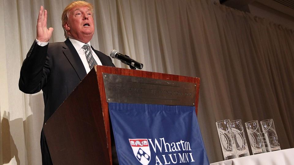 Donald Trump speaks at a podium
