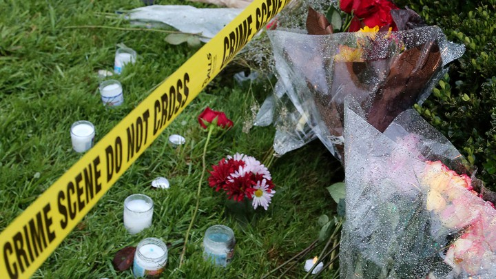 Flowers and candles outside the Tree of Life synagogue