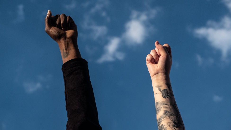 Two fists raised to the sky