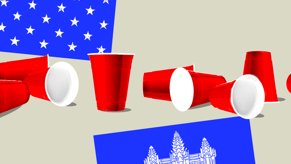 Red Solo cups between the American and Cambodian flags