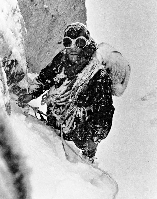 Photo of Douglas Tompkins climbing in snow, 1968