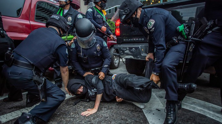 Police arrest a protester at a demonstration for Black Lives Matter in Los Angeles on May 29, 2020.