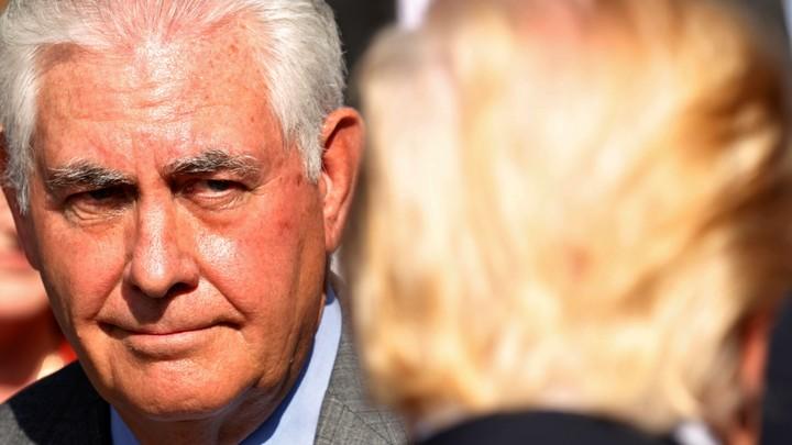 U.S. Secretary of State Rex Tillerson looks toward President Donald Trump.