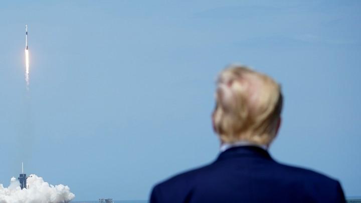 President Donald Trump watching an astronaut launch